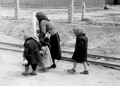 268_119An old Jewish woman takes care of the little children as they are forced to walk towards the gas chambers.jpg